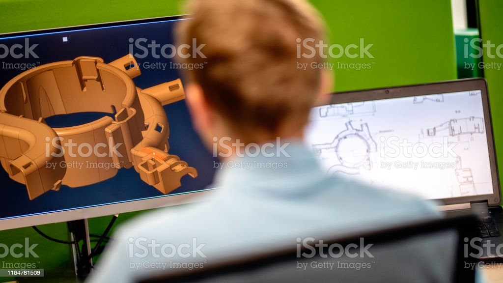 Rear view of engineer using a computer - Foto stock royalty-free di Adulto