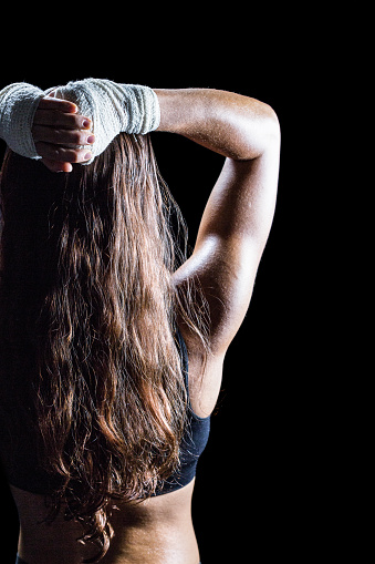 istock Rear view of female boxer with long brown hair 671166786