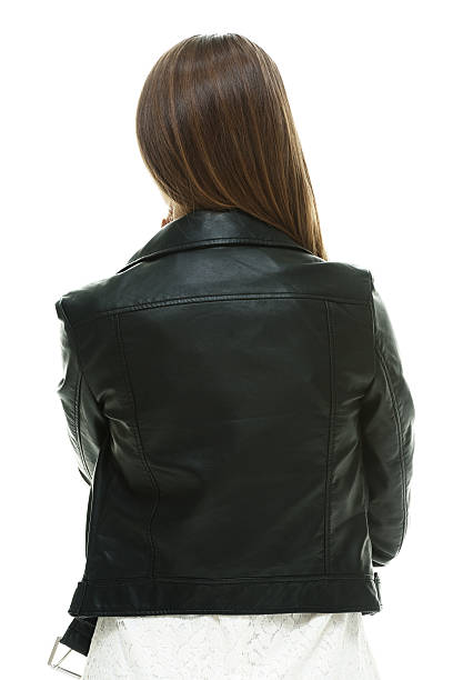 Rear view of female standing Rear view of female standinghttp://www.twodozendesign.info/i/1.png leather jacket stock pictures, royalty-free photos & images