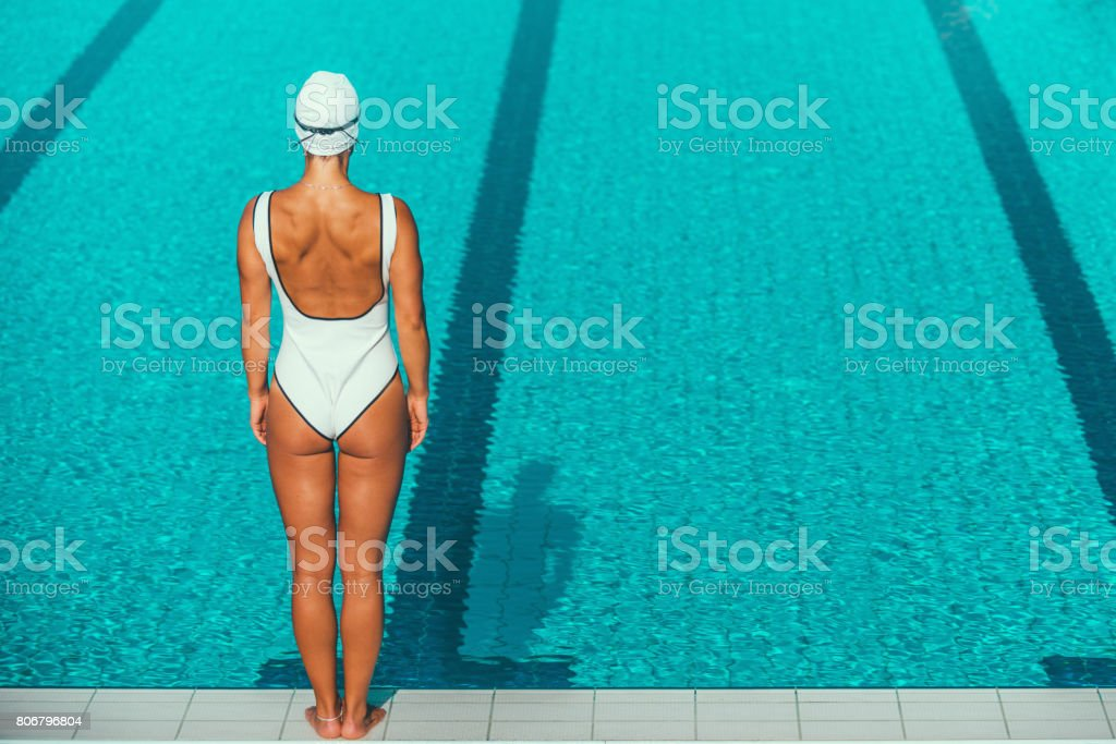 Rear view of female swimmer by the swimming pool stock photo