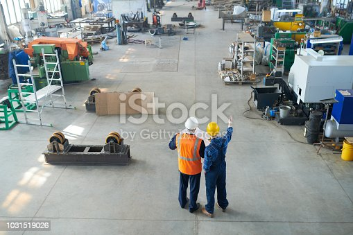 Foreman and builder at construction site