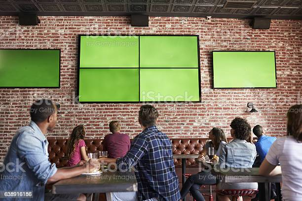 Rear view of friends watching game in sports bar on picture id638916186?b=1&k=6&m=638916186&s=612x612&h=qbudaxidif95qkxx18 xlkxegj0wvbxdvizwha2c4p8=