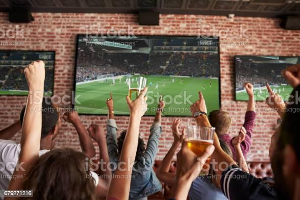 Rear view of friends watching game in sports bar on screens picture id679271216?b=1&k=6&m=679271216&s=612x612&h=0ornrc4jbazz40mn n0lgvt8bpxr0bxz2z7lmlbf2s0=