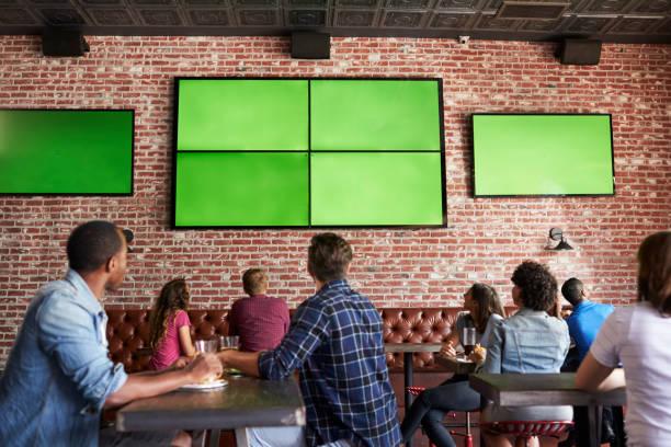 Rear view of friends watching game in sports bar on screens picture id685688240?b=1&k=6&m=685688240&s=612x612&w=0&h=s4ck txhpzx4m rya7rs7nz4q iikej9qgddn1xmzlo=