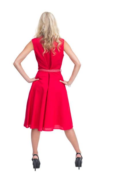 rückansicht des schöne blonde im roten kleid posieren - wickelkleid lang stock-fotos und bilder