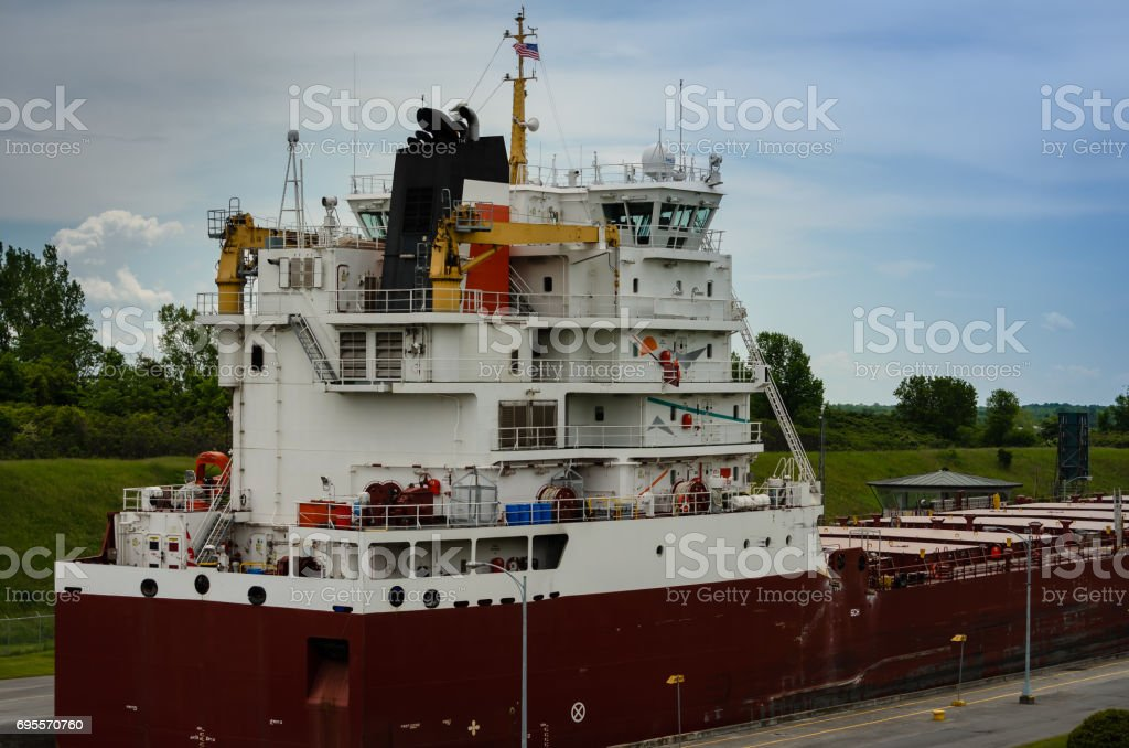 Rear view of Great Lakes Freighter in the Iroquois Lock stock photo