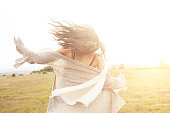 istock Rear view of happy young woman dancing in the field 531788348