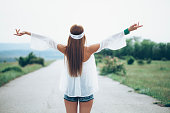 istock Rear view of happy young woman standing on the road 540596562