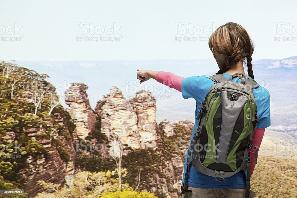 Rear view of hiker pointing away stock photo