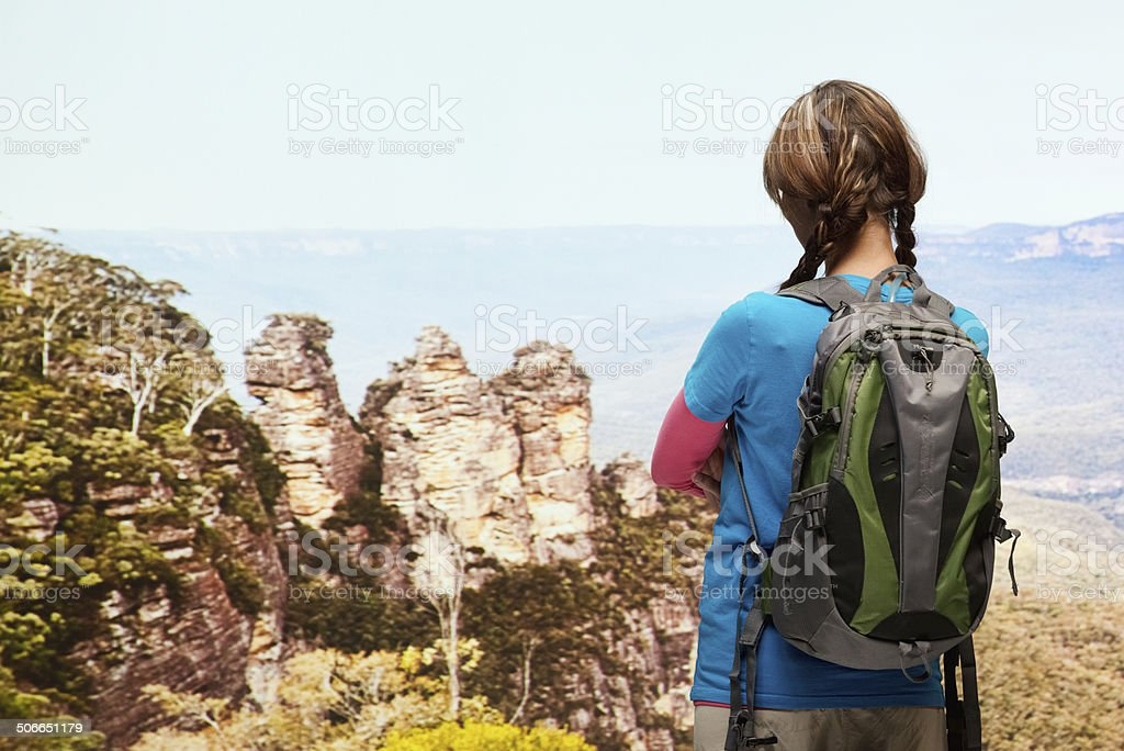 Rear view of hiker standing & looking away stock photo