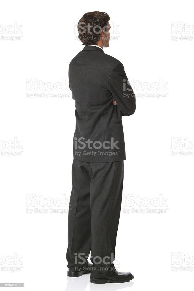 Rear view of isolated businessman arms folded royalty-free stock photo