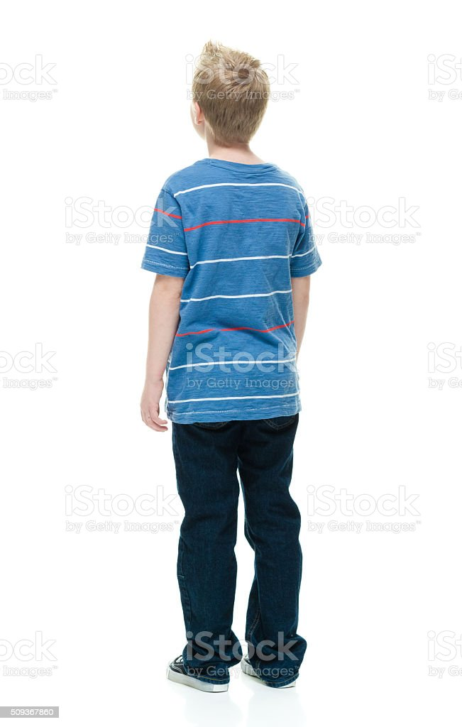 Rear view of little boy standing stock photo