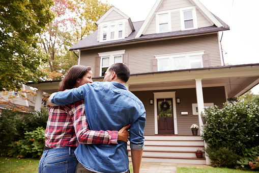 istock Rear View Of Loving Couple Walking Towards House 905902112