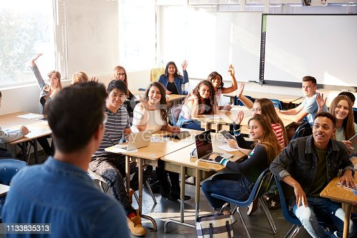 istock Rear View Of Male High School Teacher Standing At Front Of Class Teaching Lesson 1133835313