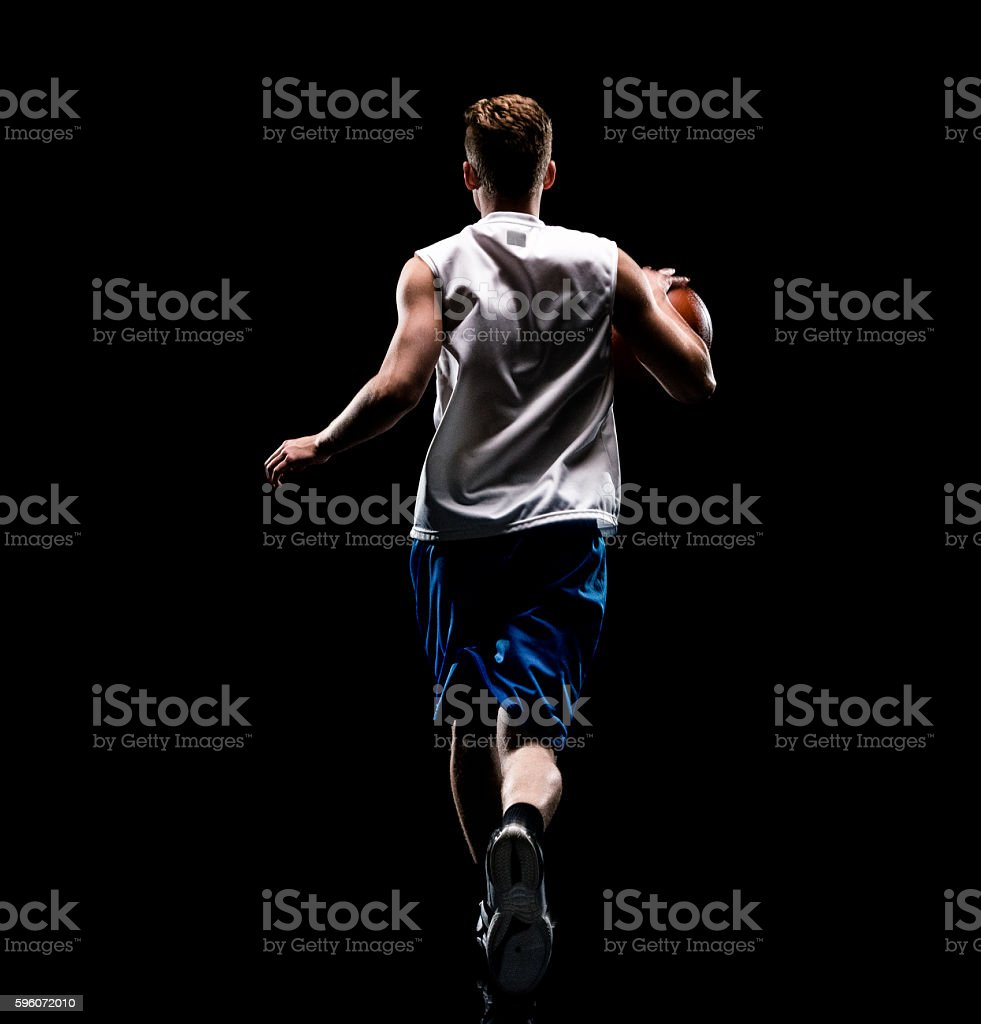 Rear view of male playing basketball royalty-free stock photo