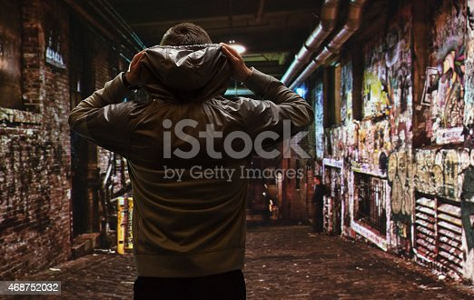 istock Rear view of male runner outdoors at night 468752032