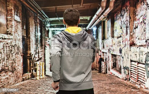 istock Rear view of male runner running outdoors 537096581