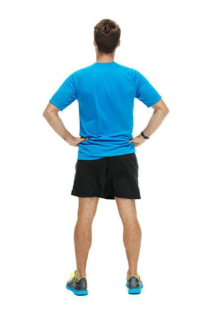 rückansicht von male runner stehen - einzelner mann über 30 stock-fotos und bilder