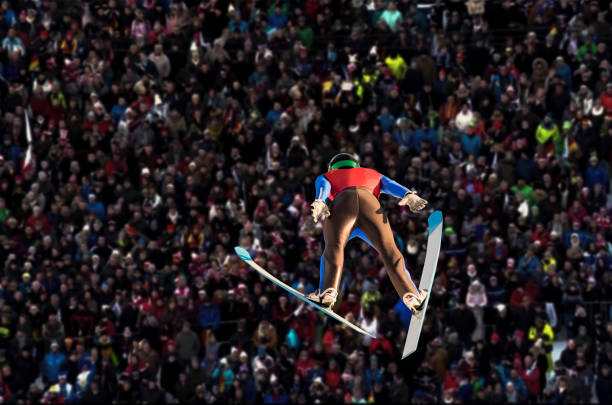Rear View of Male Ski Jumper in Mid-air stock photo
