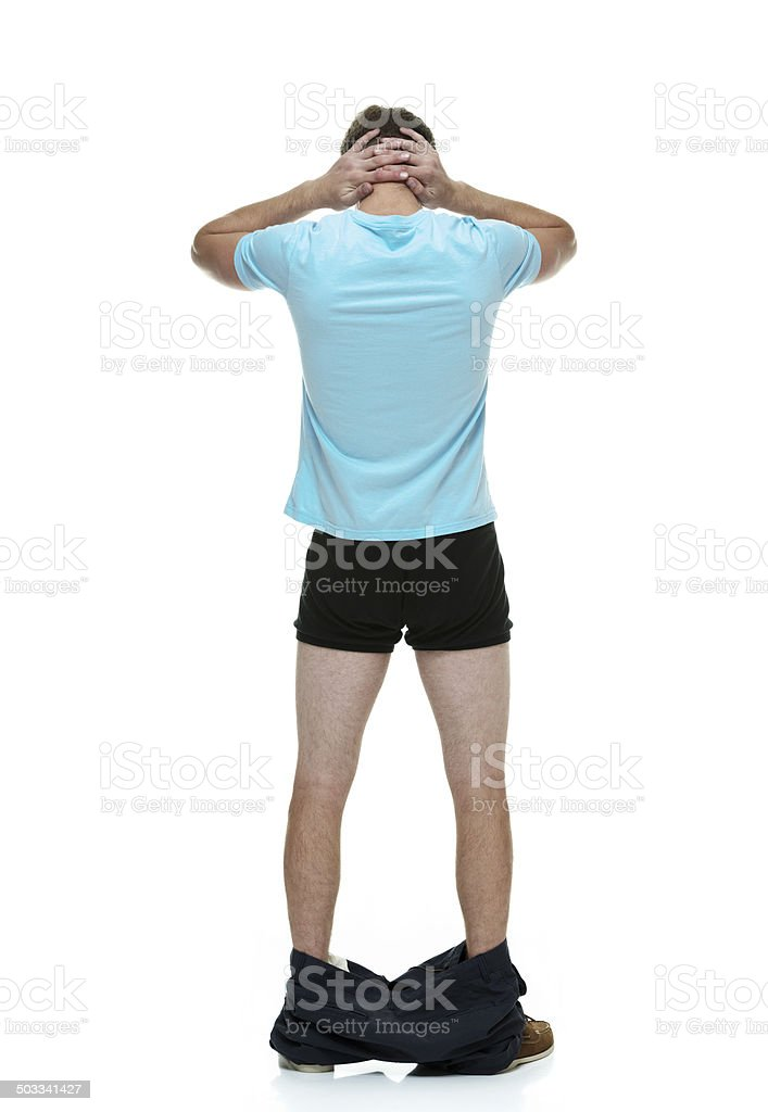 Rear view of man caught with his pants down stock photo
