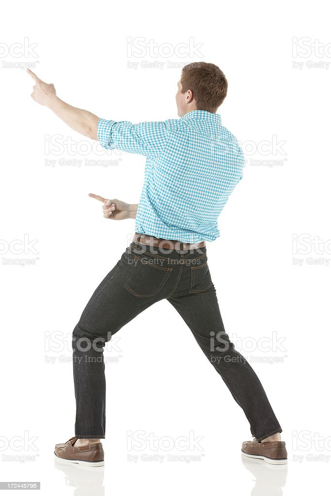 Rear view of man pointing with fingers royalty-free stock photo