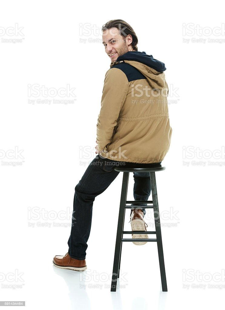 Rear View Of Man Sitting On Stool Stock Photo More Pictures Of 20 24 Years Istock
