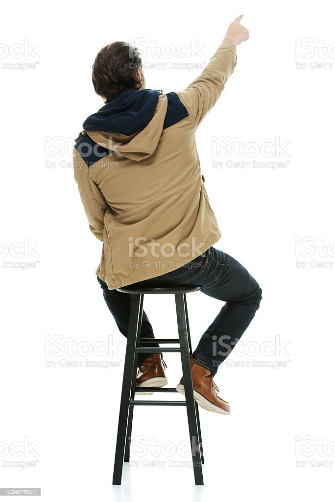 Rear View Of Man Sitting On Stool Pointing Away stock  : rear view of man sitting on stool pointing away picture id524619077 from www.istockphoto.com size 684 x 1024 jpeg 187kB