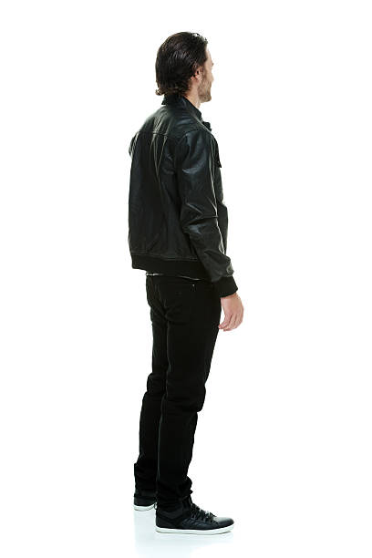 Rear view of man standing and looking away Rear view of man standing and looking awayhttp://www.twodozendesign.info/i/1.png leather jacket stock pictures, royalty-free photos & images