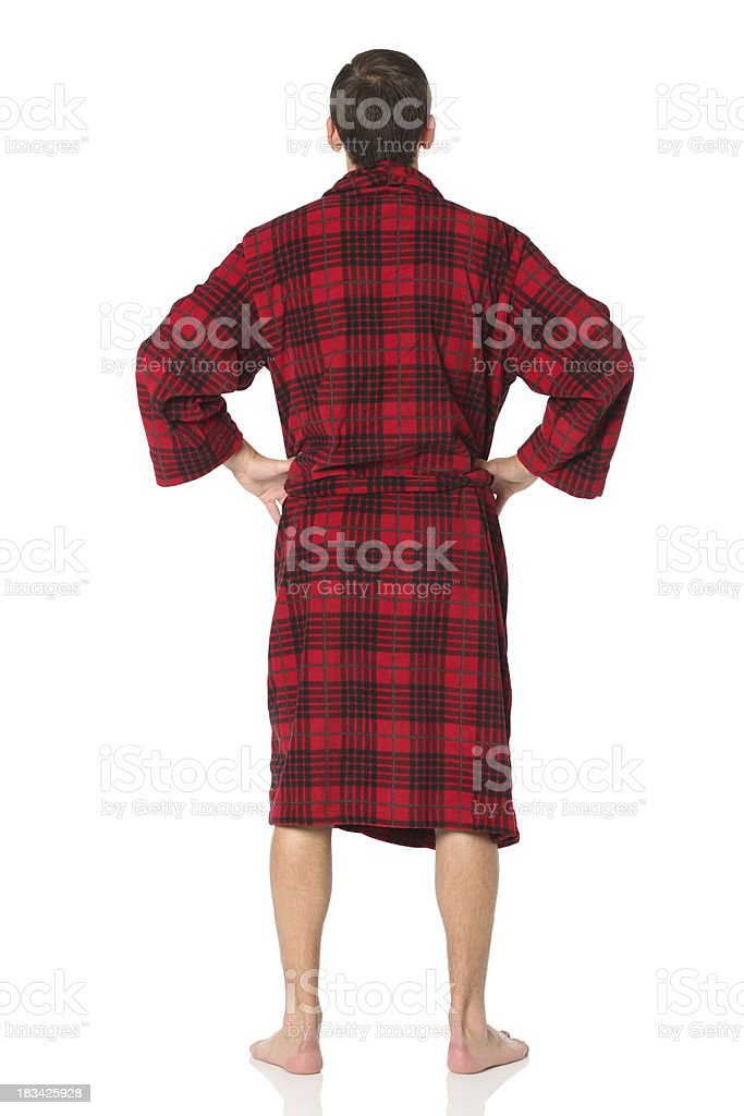 Rear view of man standing in a robe stock photo