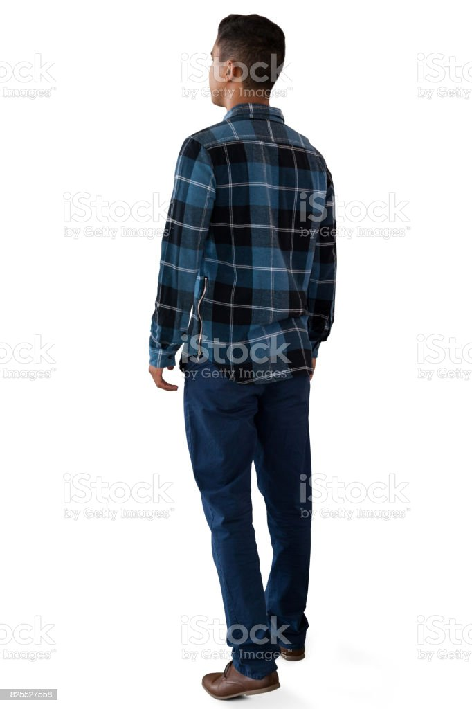 Rear view of man walking stock photo