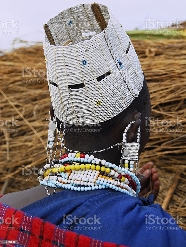 Rear view of Masai woman with traditional clothing and jewelry royalty-free stock photo