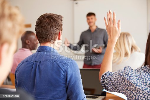 istock Rear View Of Mature College Student Asking Question In Class 876965990