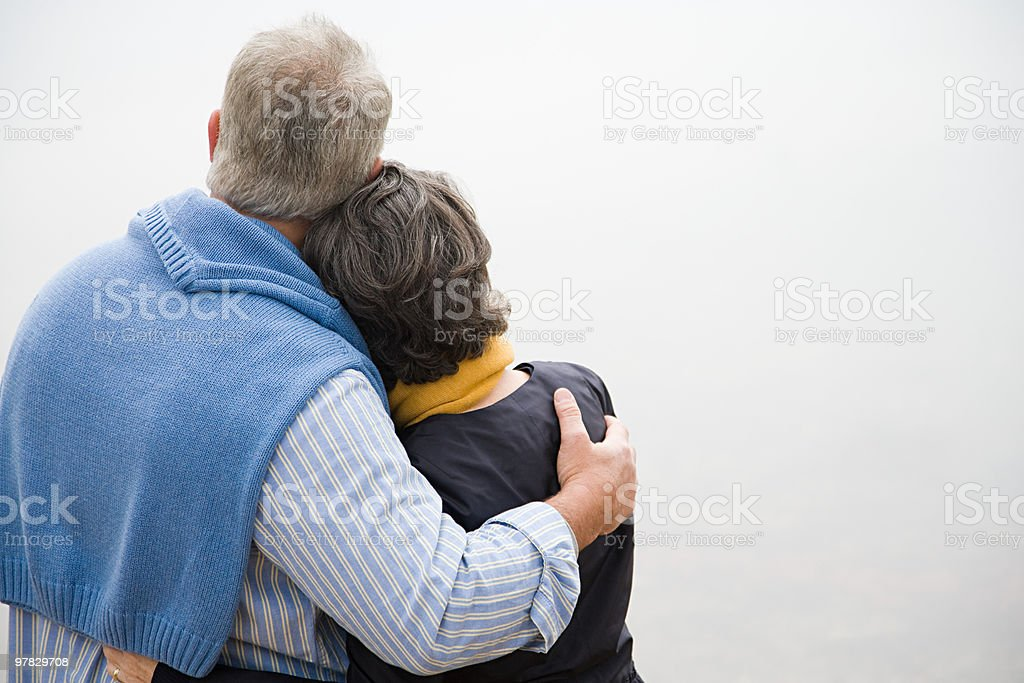 Rear view of mature couple stock photo
