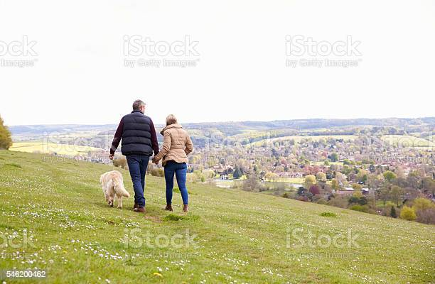 Rear view of mature couple taking golden retriever for walk picture id546200462?b=1&k=6&m=546200462&s=612x612&h=tergx2yqkgjjoewaapxzjtrosvwkftbho6msm1hi7ba=