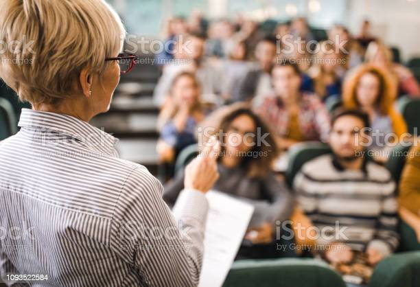 Rear view of mature teacher giving a lecture in a classroom picture id1093522584?b=1&k=6&m=1093522584&s=612x612&h=eddhfrqitpkpsvveszjbmkg1uticp2h zqrq8zknzk8=