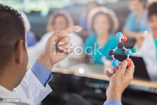 istock Rear view of medical school professor teaching 638602082
