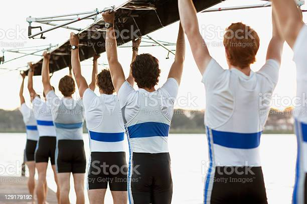 Rear view of men holding row boat overhead picture id129179192?b=1&k=6&m=129179192&s=612x612&h=mhlwackkebwr5iptkiz8xc aqh lykg13gyfv195sok=