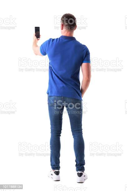 Rear view of modern adult casual man taking photo with smart phone picture id1017888134?b=1&k=6&m=1017888134&s=612x612&h=oy8gv5ryet3njekid2p2trvx78fwjxozh8cr62qzdvw=