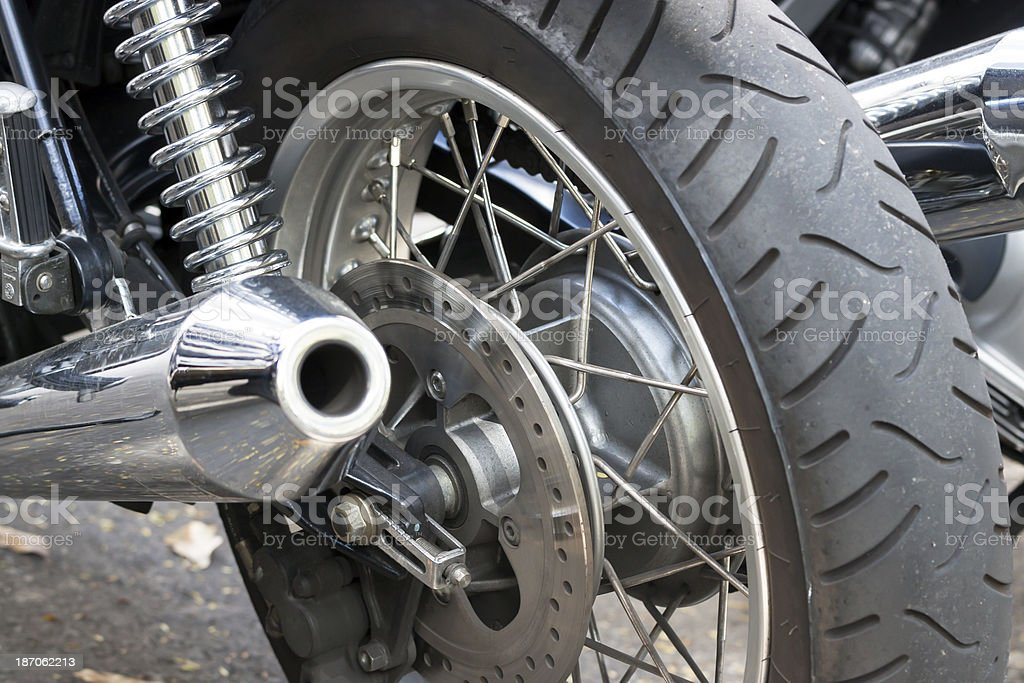 Rear view of motorcycle wheel and exhoust pipe stock photo