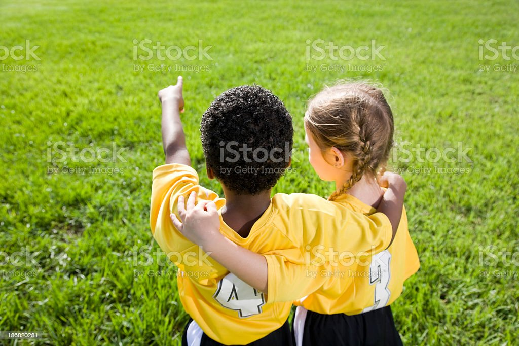 Rear view of multiracial children in sports team uniforms royalty-free stock photo