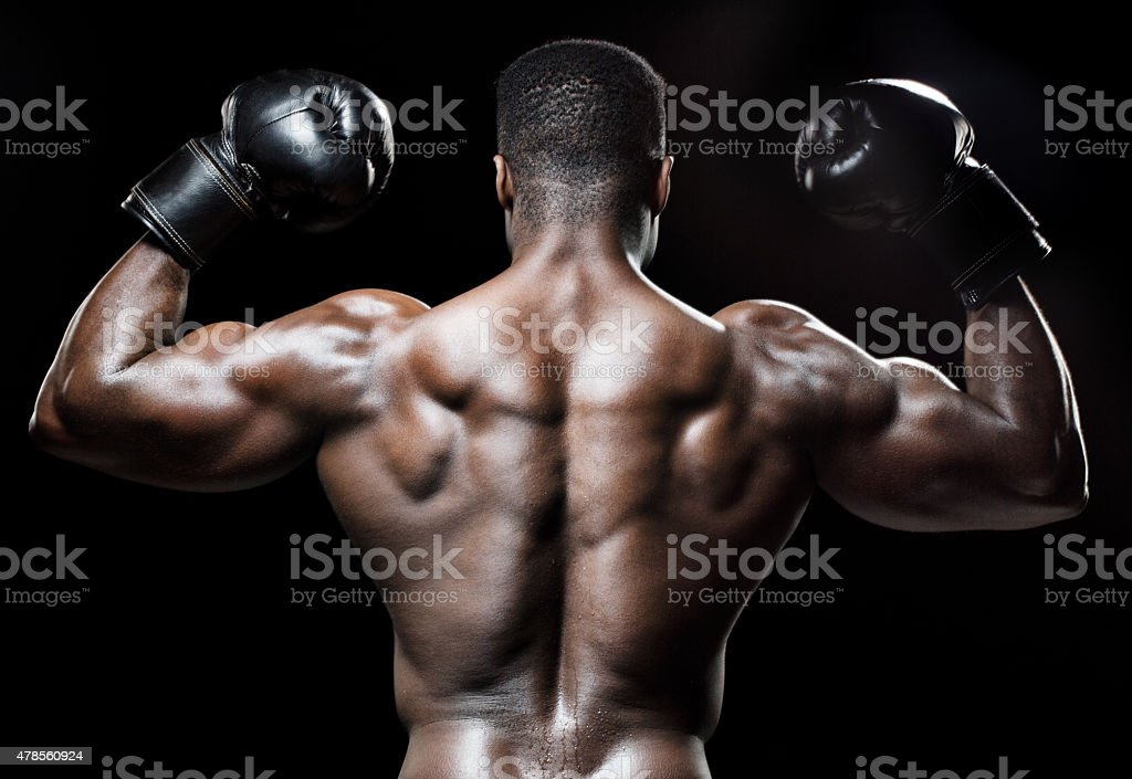 Rear view of muscular black male stock photo