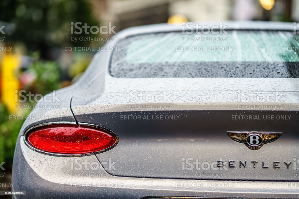 Rear view of NEW BENTLEY CONTINENTAL GT is waiting under rain in London, Covent Garden stock photo