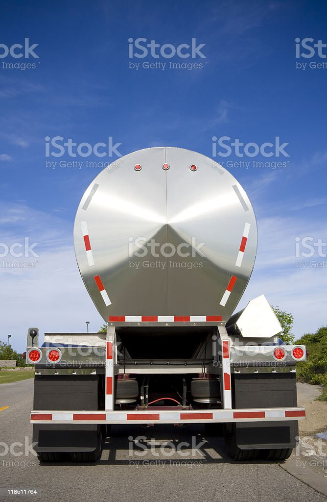 Rear view of oil or liquid tanker shot on road stock photo