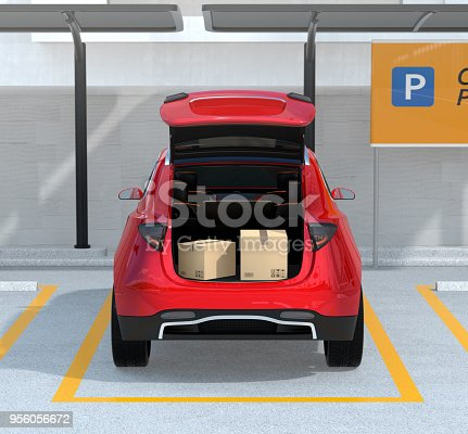 istock Rear view of opened red car trunk with package boxes inside 956056672