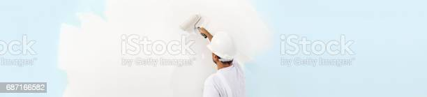 Rear view of painter man painting the wall with paint roller isolated picture id687166582?b=1&k=6&m=687166582&s=612x612&h=icysqkubhklpxjz0xhxyoi0ndahqdywrb8qd8gykco4=