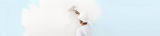 Rear view of painter man painting the wall with paint roller isolated picture id687166582?b=1&k=6&m=687166582&s=612x612&w=0&h=yciy5w0lbzx2dkqviwbsbvbld yt7dlrnpyf5r5mgz8=