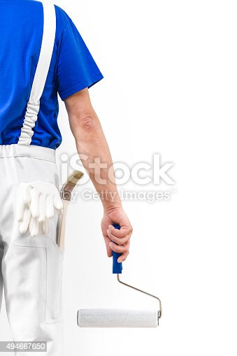 589454570 istock photo Rear view of painter man with paint roller 494667650
