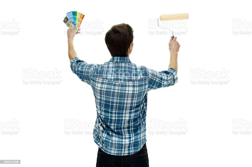 Vista posterior de artista pintando foto de stock libre de derechos