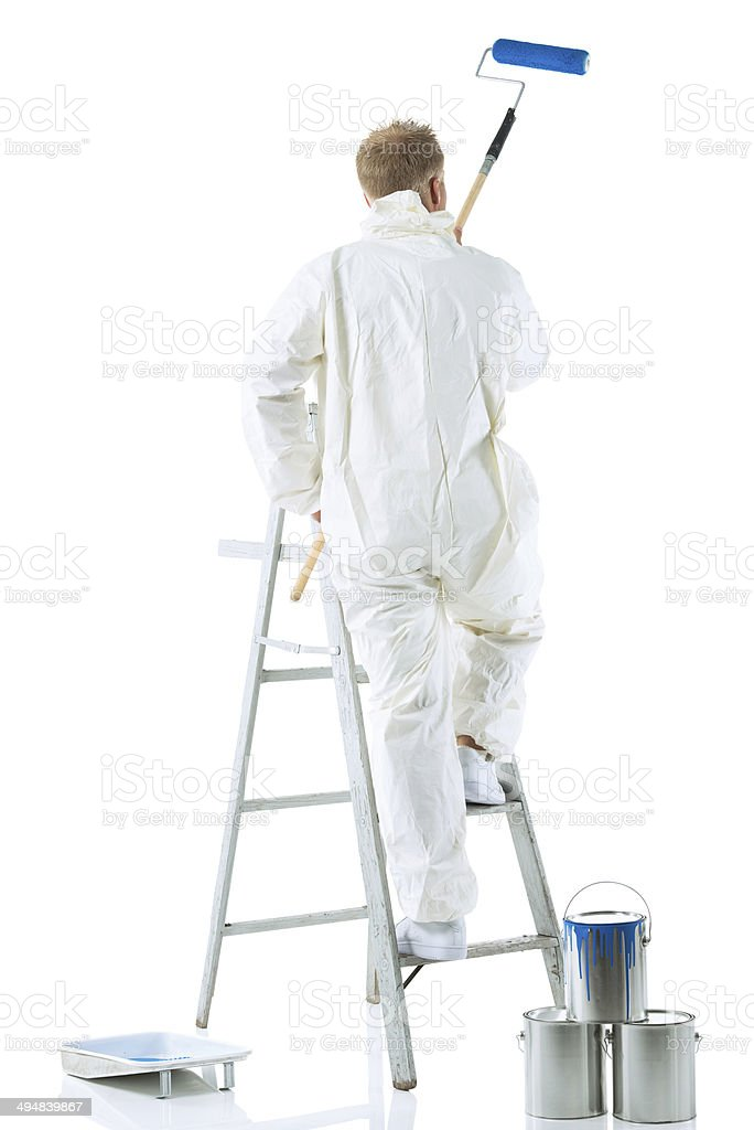 Rear view of painter working stock photo