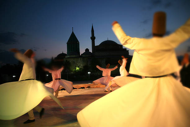 Rear view of people dancing outdoors at the Mevlana museum stock photo